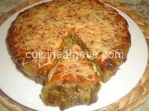 Maqlouba d'aubergine au poulet, champignons et fromage